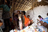A group of 'Distressed Seasonal Migrant Workers', at a salt plant, in Tutcorin,Tamilnadu, India This type of temporary migration is a growing phenomen...