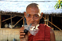 An elderly man from ethnic community smokes a pipe Tidu in Bandarban, Bangladesh December 2, 2009