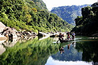 Men on a boat on the Sangu river in Bandarban in Bangladesh December 3, 2009