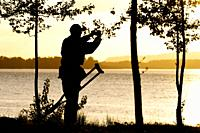 Disable man is taking a photograph of the sunset at the Columbia river, Oregon, USA