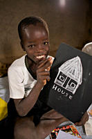 A boy shows his artwork, during an art class, at a BRAC Non Formal Primary School NFPE, in the Munuki neighbourhood of Juba, the capital of South Suda...