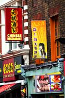Chinese Restaurant, Hair Salon and Herbalist Shop signs on Wardour Street, Chinatown, London, England, UK