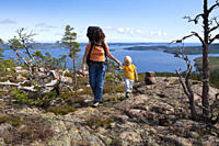 A woman and a girl hiking at the national park Skuleskogen, Hoega Kusten, Vaesternorrland, Sweden, Europe