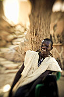 Laughing young man of the Dogon people, Falaise de Bandiagara, Mali, Africa