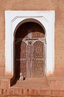 An arched doorway with cat at the Taourit Casbah in Ourzazate, Morocco