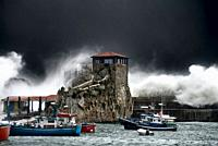 Castro Urdiales giant wave caused by a severe storm in the Bay of Biscay, one can see the hermitage of Santa Ana, surrounded by the wave