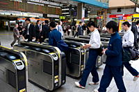 Passengers passing through automatic ticket wickets upon entering the JR Ueno railway station in Tokyo, Japan, Asia