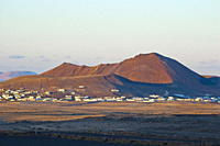 Volcanic cinder cones and the town of Soo at sunset in the mid north of the island, Soo, Lanzarote, Canary Islands, Spain, Atlantic Ocean, Europe