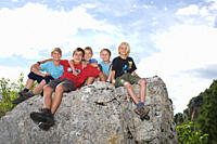 Group of children on top of mountain