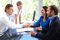 Doctors with patients, in office
