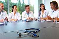 Doctors meeting, stethoscope on table