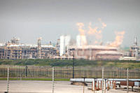 Flaring off gas at a gas processing plant at Rampside near Barrow in Furness, UK, that processes gas from the Morecambe Bay gas field, it is one of th...
