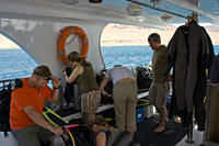 Divers preparing their dive equipment for a boat dive Dahab, Egypt