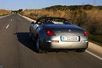 Car, Nissan 350 Z Roadster, model year 2004_, anthracite, Convertible, driving, diagonal from the back, rear view, country road, open top
