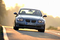 BMW 335i Coupe, model year 2006_, anthracite, driving, diagonal from the front, frontal view, country road