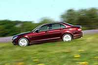 Mercedes C 220 CDI Avantgarde, model year 2007_, ruby colored, driving, side view, country road