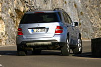 Mercedes ML 420 CDI, model year 2007_, silver, driving, diagonal from the back, rear view, country road