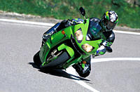Sports motor cycle, Sportsman, Kawasaki Ninja ZX_12R, green, model year 2003, driving, inclined position, Knee on the groand, Side position, from the ...