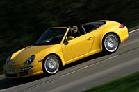 Car, Porsche 911 Carrera S Convertible, model year 2005_, yellow, open top, driving, diagonal from the front, frontal view, side view, country road