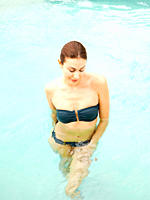 Mixed race woman standing in swimming pool