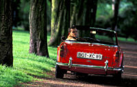 Car, Triumph TR 4, vintage car, model year 1962, 1960s, sixties, red, convertible, convertible top, open, standing, diagonal back, back view, road, co...