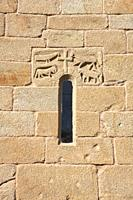 Spain, Galicia, Parada de Sil, Bas relief on exterior of church