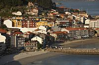 Spain, Galicia, Rias Baixas, Raxo, View of crowded houses near beach