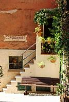 France, Cote d'Azur, Biot, View of steps and plants at cobbler shop