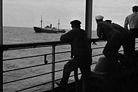 Sailors at the railing watching a ship passing by. Navigation, North German Lloyd, ship Columbus, navigation, steamboat, passenger liner, steamer. Col...