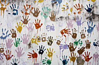 collage of children hand prints in paint on a wall outside an orphanage, Hetauda, Makwanpur district, Narayani, Nepal