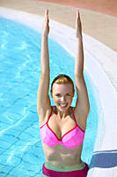 young woman doing acqua gymnastics in the swimming
