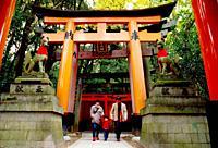 A family walking together at Fushimi Inari Kyoto Japan