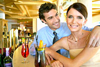 young couple flirting at hotel bar