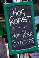 Sign advertising a Hog Roast and Pork Sandwiches at a Food Festival in England