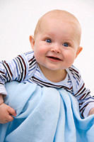 Baby boy 6_11 months smiling, looking away