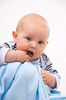 Baby boy 6_11 months with finger in mouth, portrait