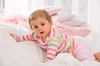 Baby girl 6_11 months crawling on blanket