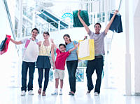 Happy family shopping together in mall