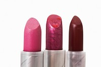 Three lipsticks against white background