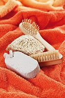 Sponge, brushes and pumice on towel