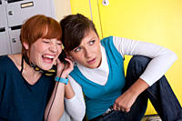 Germany, Leipzig, University students enjoying listening music in locker room
