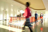 Germany, Leipzig, University students walking through corridor blurred motion