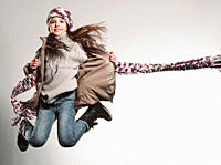 Girl 8_9 wearing jacket jumping, smiling, portrait