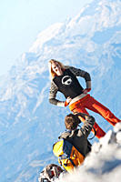 Austria, Steiermark, Dachstein, Man taking photograph of woman on mountain top