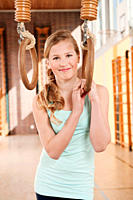 Germany, Emmering, Girl 12_13 holding flying rings and smiling, portrait