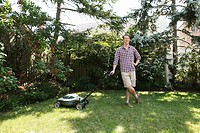 Man leaning on lawnmower