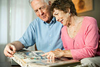 Senior couple looking at family album