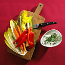 Sliced vegetables on chopping board