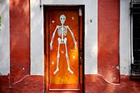 A skeleton decorates a home's door in Coyoacan ahead of Day of the Dead celebrations, Mexico City