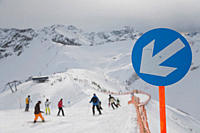 Germany, Oberstdorf, slope sign, Slope sign with skier skiing in background